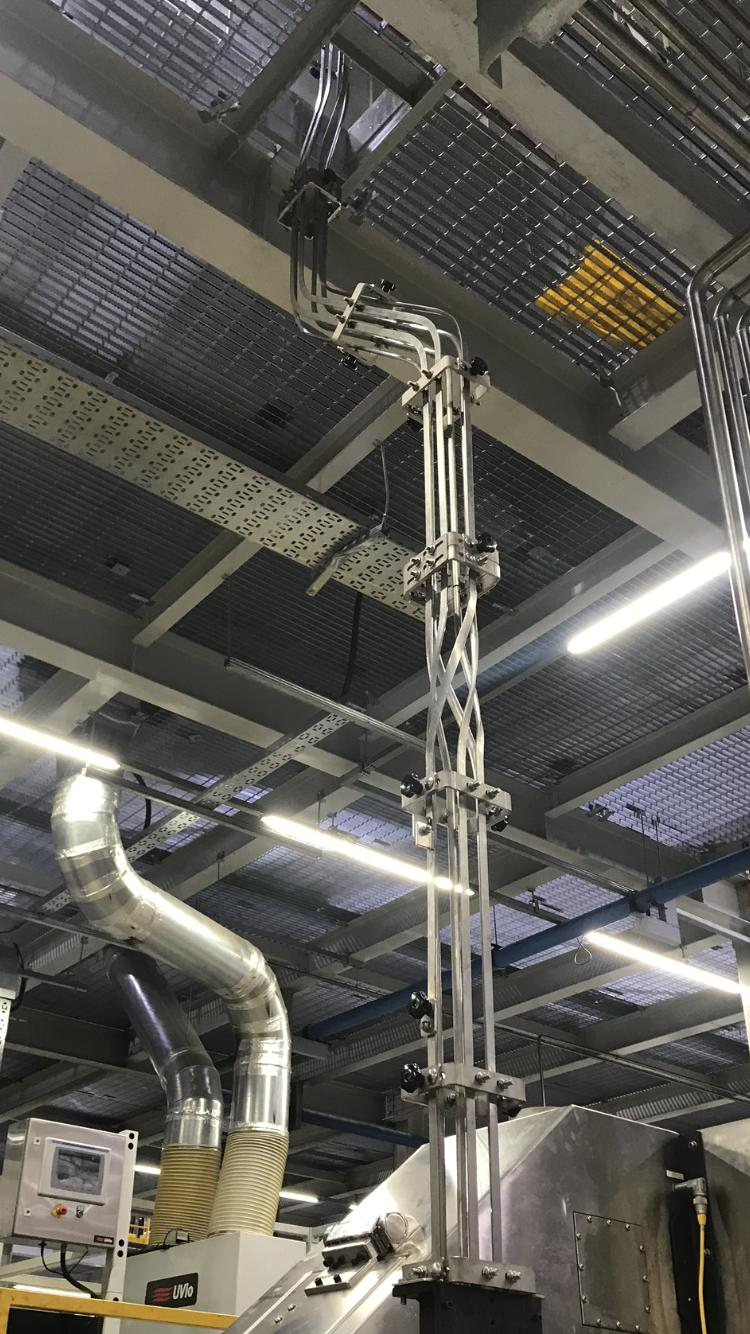 Vertical Can Twists In a can-making factory
